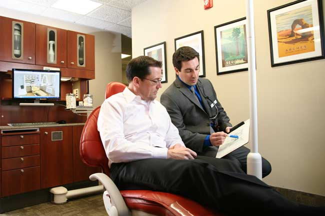 Dr. Daniel DiMatteo consults with patient at North Easton Dental Associates